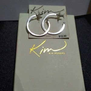 Kim Rogers costume silver color hoop earrings.